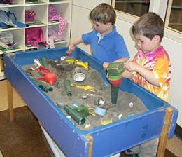 Photo of Congregational Preschool children playing in sandbox