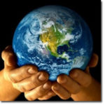 photo of hands holding the world